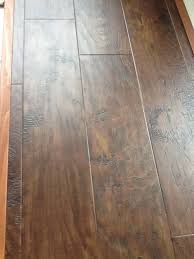 flooring contractors are suggesting vinyl plank flooring in the walk out basement the floors are heated concrete i have been considering porcelain tile
