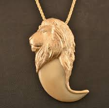 this is one of the biggest claws we have mounted in 14 karat yellow gold weighing around 2 ounces a real show stopper