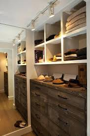 fantastic walk in closet with track lighting floor mirror rustic chest of drawers an antique finish