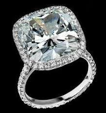 ring with 10 11 carat cushioned shaped diamond set on platinum and enhanced with round brilliant