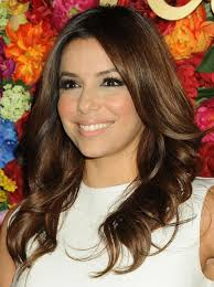 eva longoria hairstyles center parted curls