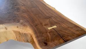 walnut crotch coffee table with brass bowtie key