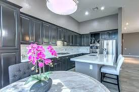kitchen with white cabinets dark gray and painted walls island black countertops co