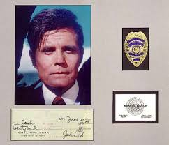the hawaii five o home page mounted displays jack lord s autograph