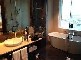 intercontinental dubai festival city bath shower room behind glass door at rear
