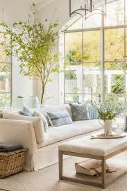 Belgian linen family room with interior design by Giannetti Home - found on  Hello Lovely Studio. Modern Farmhouse Interior Design Inspiration