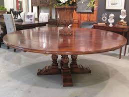 antique oak 60 round 4 baer base dining table with outer leaves