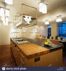 kitchen dining lighting. Suspended Stainless-steel Shelving And Ceiling-lights Above Island Unit In Large Loft Conversion Kitchen Dining Room Lighting S