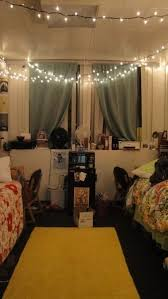 her dorm room is soooo cute i love the curtains they added and xmas lights adorable looks like it came straight out of pottery barn teen lighting h54 dorm