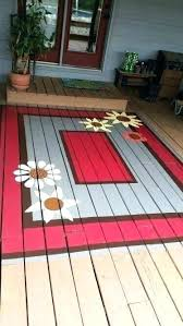 outdoor rug wood deck on front porch and wicker patio furniture with carpet replacing boards