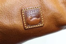 dooney bourke floine leather domed buckle satchel