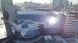 office centre video. Aerial View Of Office Building. Close Orange Glass Reflecrions. Flying Over Research Center - Solar Energy Power. Panels On The Stock Video Centre P