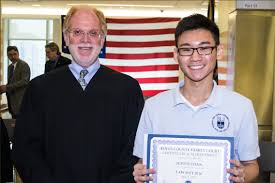 family court celebrates the m da warning at law day event alan beckoff this year s law day essay contest winner justin chan from