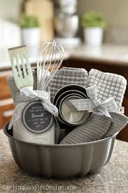 you should consider giving a themed gift basket that contains cooking utensils and other kitchen stuff soaps and stuff for the bathroom etc