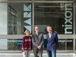 nixon office. Anna Hart, John Miller And Martin Nixon Standing Outside Their Joint Office In London. H