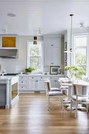 Tile Backsplash White Cabinets Black Countertops Wooden Kitchen