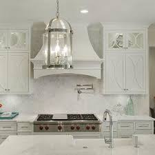 white kitchen cabinets. Off White Kitchen Cabinets With Marble Countertops M