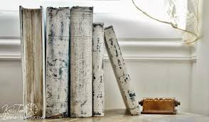 white painted books with chalk paint white antique upcycled books br perpetual calendar