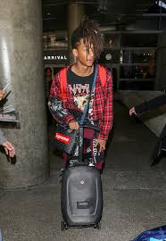 louis vuitton x adidas nmd. he was wearing a red plaid shirt, custom msftsrep jeans and louis vuitton bag with supreme sticker plastered across the x adidas nmd e