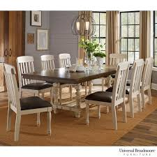 universal broadmoore extending dining room table 8 chairs