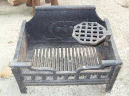 antique cast iron fireplace insert with kettle stand