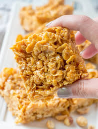 hand holding peanut caramel frosted flakes bars