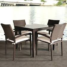 indoor rattan dining chairs sets liberty person resin wicker patio set with glass top table and stacking ultimate uk appealing space round green carpet