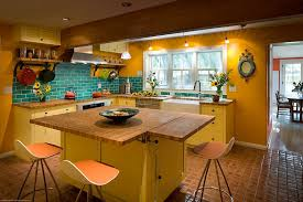 View in gallery Beautiful farmhouse style kitchen in yellow and blue  [Design: Fieldwork Architecture]