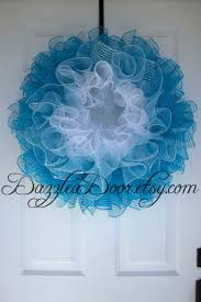 Blue Ombre Curly Q Deco Mesh Wreath. White, light blue, and teal deco