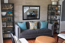 charming living room with cabinets and wall mirror also grasscloth wallpaper with sectional sofa