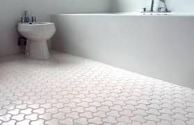 unique design of bathroom floor tile ideas colored in white to create cozy place