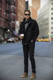 if you use a more casual approach to dressing up why not opt for a black sunglasses grey long sleeve shirt black pea coat black skinny jeans