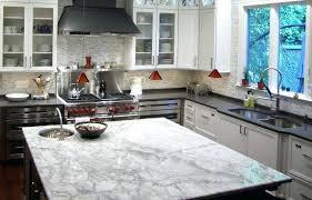 white fantasy kitchen island looks like marble quartz look which granite