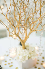 gold branches centerpieces- would like this with silver branches