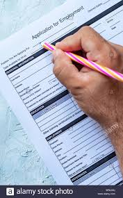 Hand Filling Standard Application For Employment Hr Hiring
