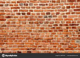 old brick wall background texture of building facades stock photo