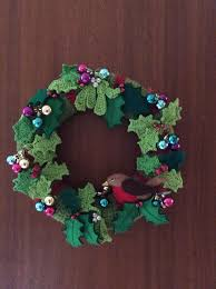 Christmas wreath using crochet, felt and baubles on a polystyrene wreath  ring