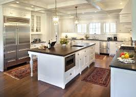rugs for wood floors dark wood floors kitchen traditional with area rugs brass pendant image by rugs for wood floors rug in kitchen