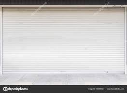 white metal roller door shutter background texture stock photo