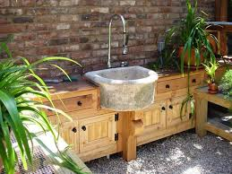 Outdoor home decor, garden house with stone sink and wooden cabinets
