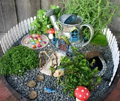 garden landscaping: Fabulous Red Mushroom On Dark Gravel For Fairy Garden  Decorations With Wood Stapping