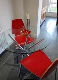 round glass table 90cm with two red chairs