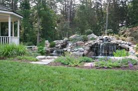 pond waterfall design in northern virginia there you have it the humble timber retaining wall