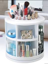 rounded white fibergl make up organizer with several open shelves as well as kim kardashian makeup