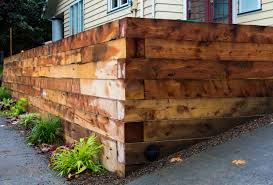 stacked 5x5 timbers paired with decomposed granite more ideas for juniper retaining walls