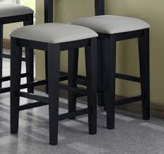3 pcs black wood 24 inch bar stools with fabric cushioned seat and granite grey floor