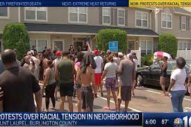 Protesters surround home of man who ...