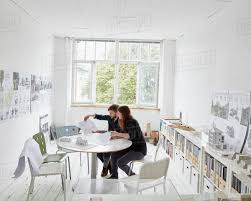 Modern office plans Office Space Modern Office Two People At Meeting Discussing Plans Architectural Drawings And Building Models Sellmytees Modern Office Two People At Meeting Discussing Plans