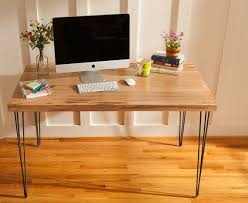 Mid century modern desk featuring an Ambrosia Maple wood top with hairpin  legs