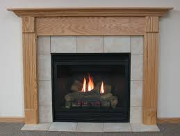 interior black gas fireplace repair with hardwood framing fireplace and ceramic design around white painted wall